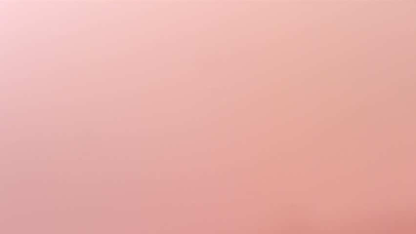Fresh strawberries splashing into pink cream, slow motion #4693805