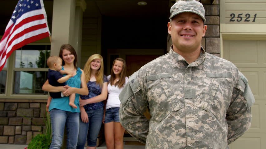 Portrait of American soldier with family in background