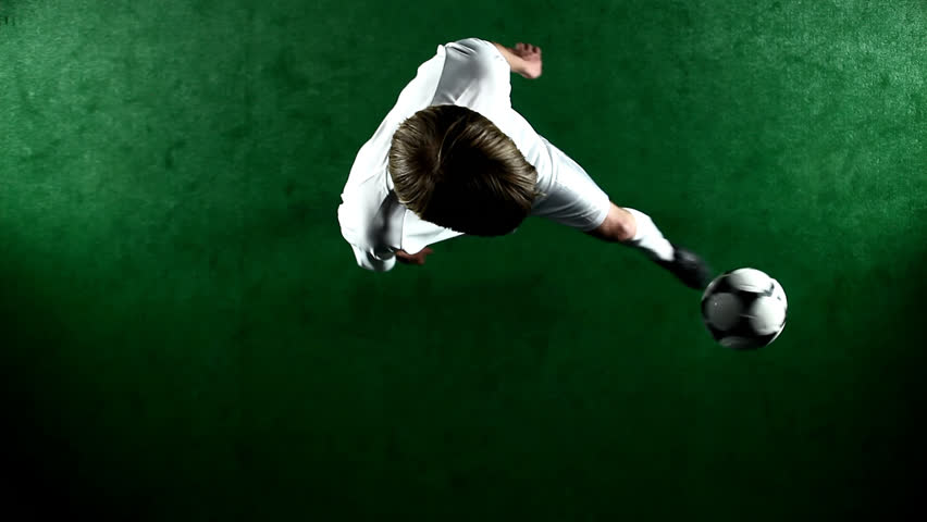Over head view of a soccer player juggling and doing tricks with the ball #4706966