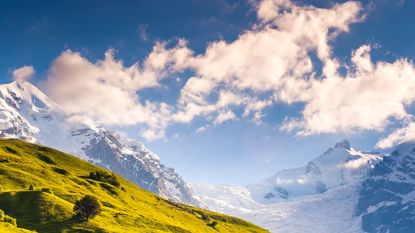 Time lapse clip. Alpine meadows at the foot of Tetnuldi glacier. Upper Svaneti, Georgia, Europe. Caucasus mountains. Beauty world. HD video (High Definition).