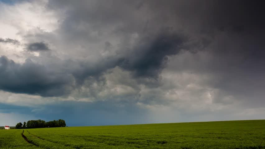 Time lapse clip. HD video (High Definition). Field with overcast sky. Dark ominous clouds. Ukraine, Europe. Beauty world. #4726019
