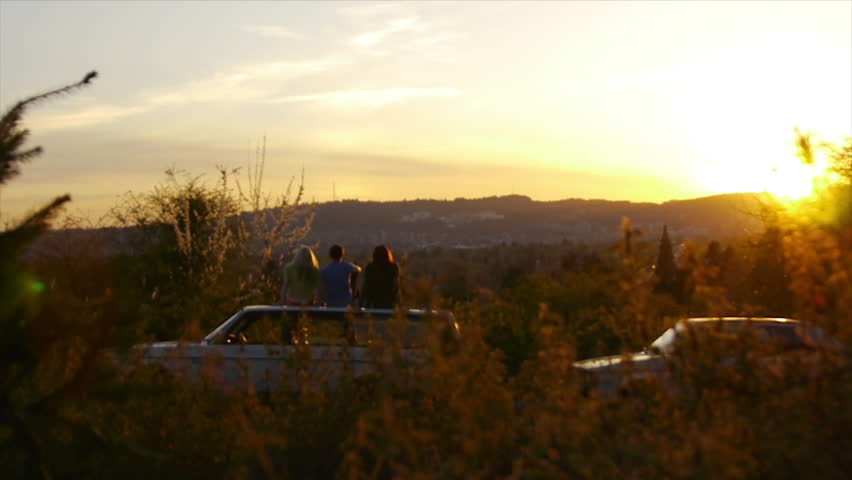 3 Teens Sit On Car And Watch The Sunset Together | Shutterstock HD Video #4727591