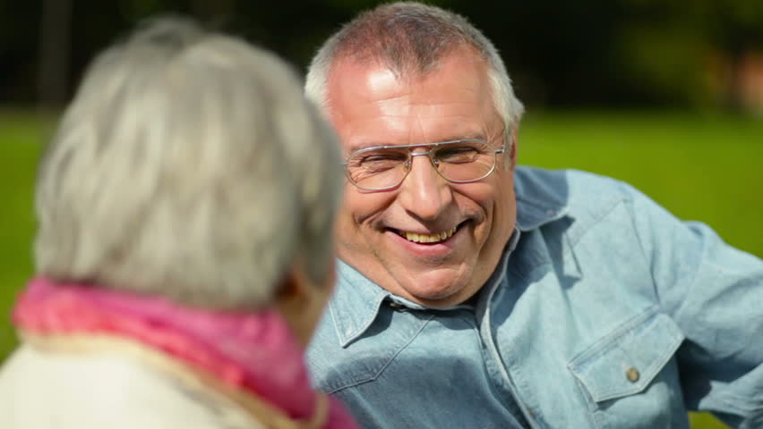Optimistic elderly couple being outdoors, man laughing #4728734