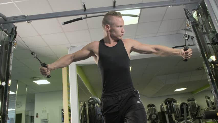 Young Muscular Bodybuilder Training Chest Muscles | Shutterstock HD Video #4730084