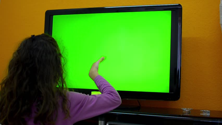 Girl do smart TV touchless gestures dolly shoot right to left, 1080. showing the use of touch less control on smart tv without touching it on green screen chrome key