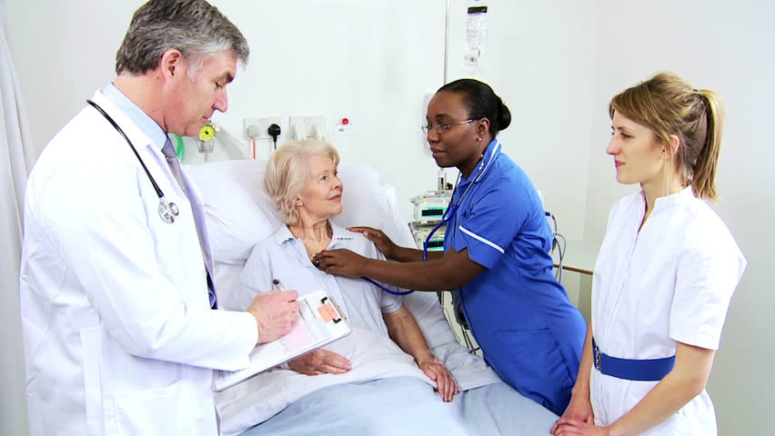 African American nurse using stethoscope to check the vital signs of an older female cardiology patient   Shutterstock HD Video #4761443