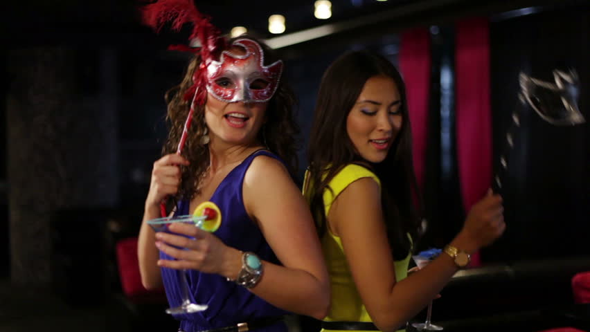 Girls in masks partying when their friend fires a petard with confetti | Shutterstock HD Video #4778396