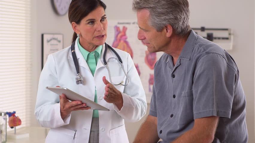 Doctor sharing patient's upcoming medical procedures