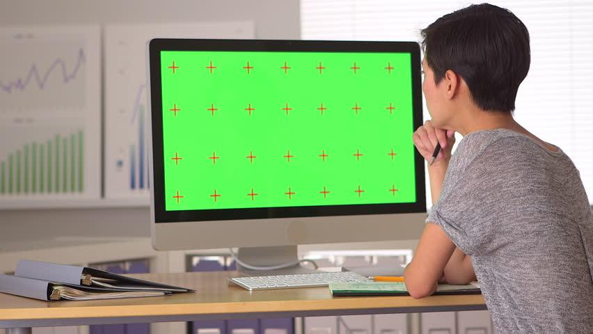 Chinese businesswoman analyzing green screen