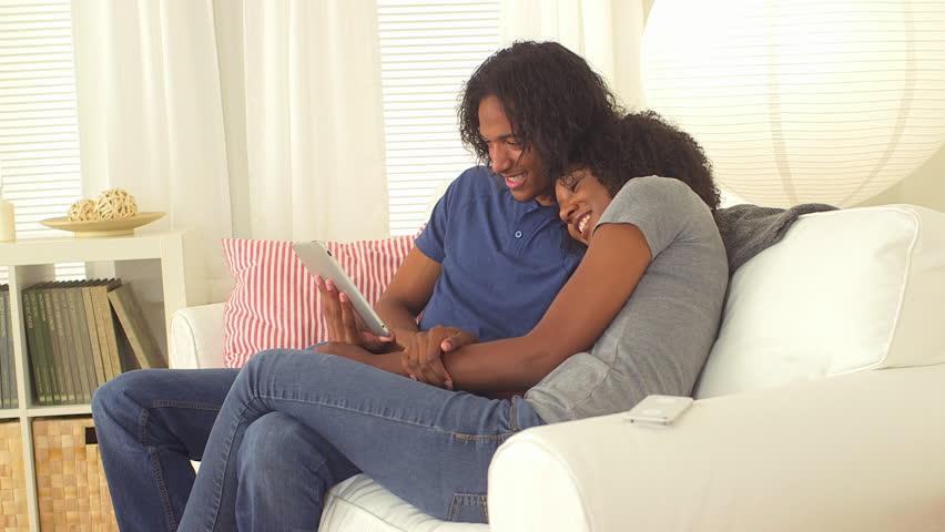 Sweet black couple watching videos on tablet | Shutterstock HD Video #4783856