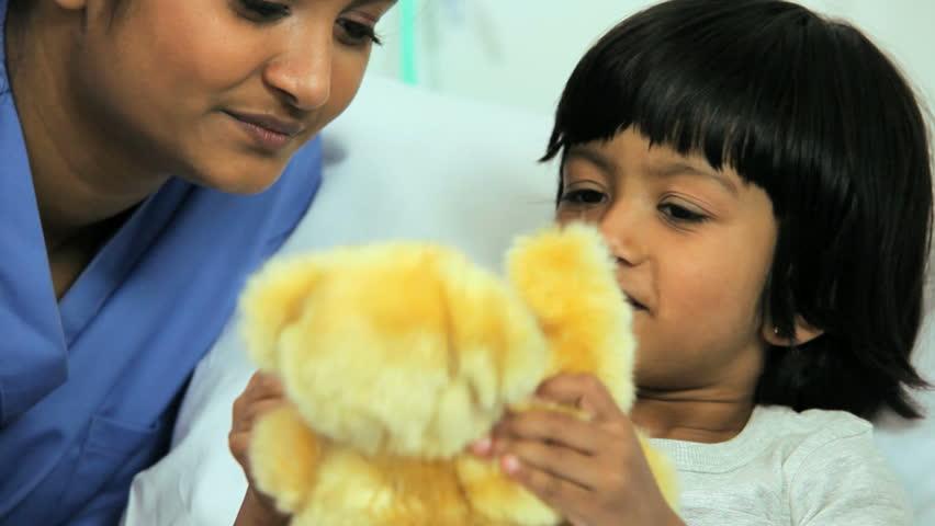 Dedicated nurse gives a sick little girl a teddy bear for comfort in a children's hospital | Shutterstock HD Video #4784552