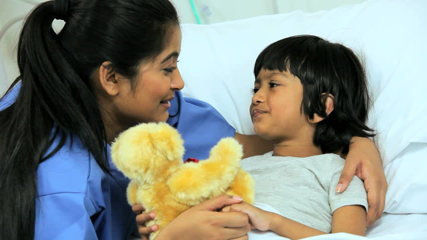 Female nurse spending time playing with a cute pediatric patient with a teddy bear   Shutterstock HD Video #4784588