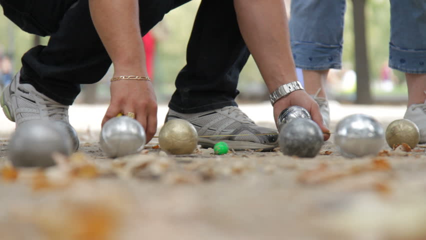 Friends play boules in Paris