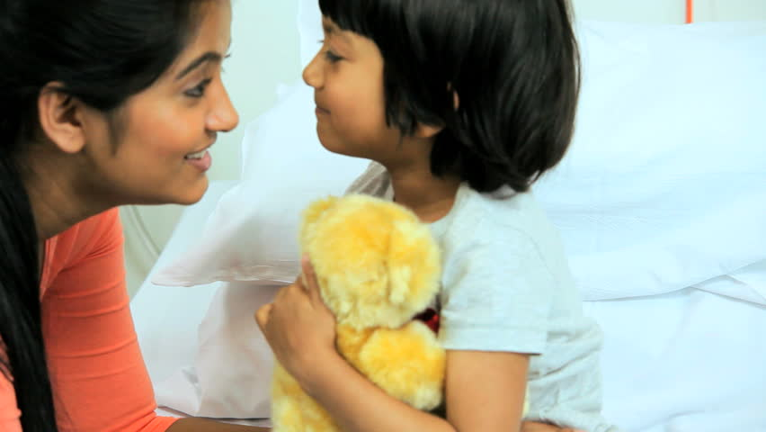 Mother comforting young daughter in the hospital and bringing her a teddy bear   Shutterstock HD Video #4785377