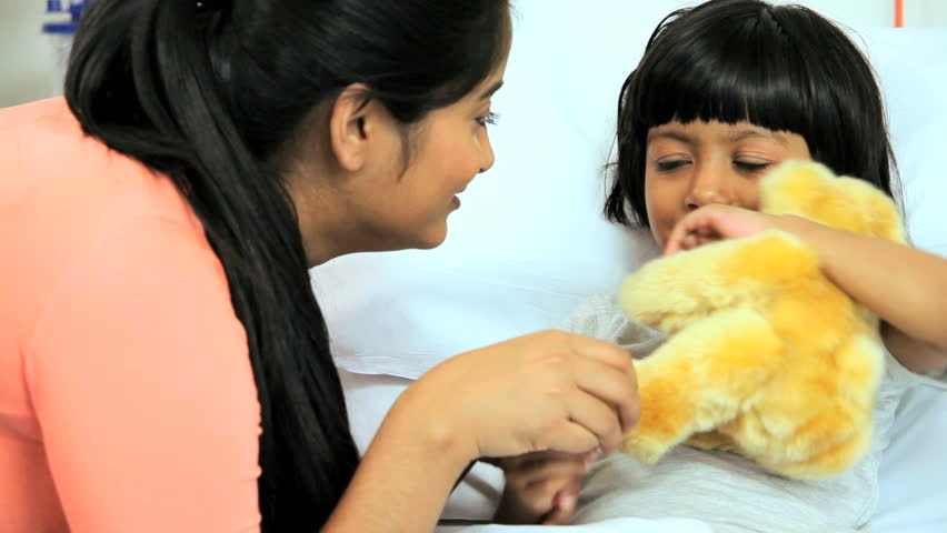 Close up of South Asian mother hugging her sick daughter at a children's hospital   Shutterstock HD Video #4785401