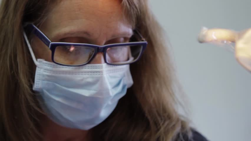 Dental Hygienist working in dental office with patient (Close up) | Shutterstock HD Video #4787087