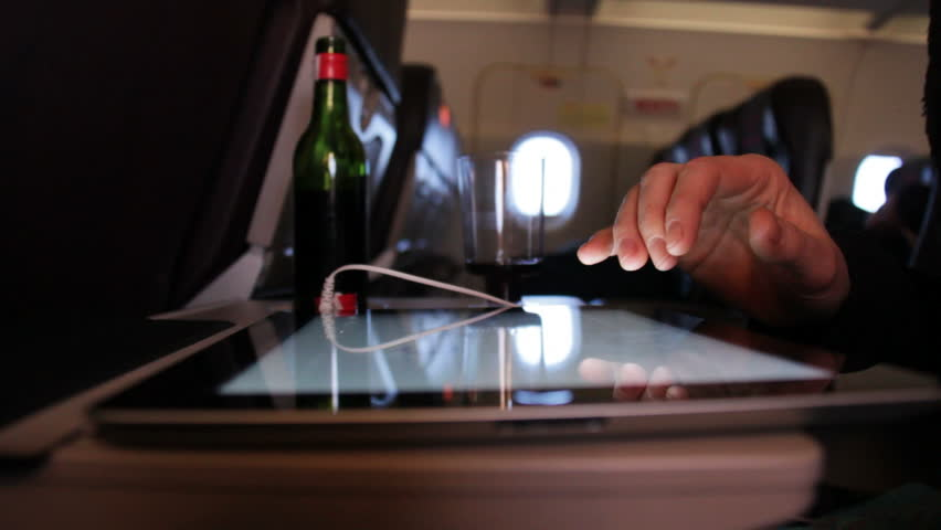 Wine and tablet on plane