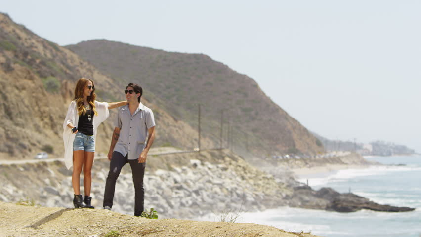 Couple taking a picture on the coast | Shutterstock HD Video #4791875