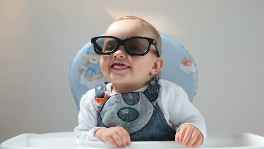 Baby plays with 3D glasses