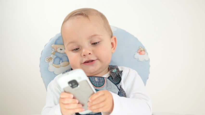 Baby plays with cellphone