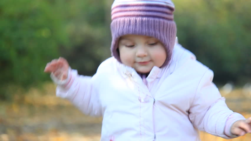 Cute baby walks in park