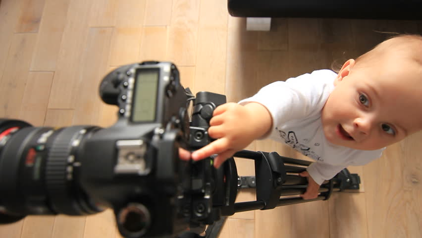 Baby plays with camera
