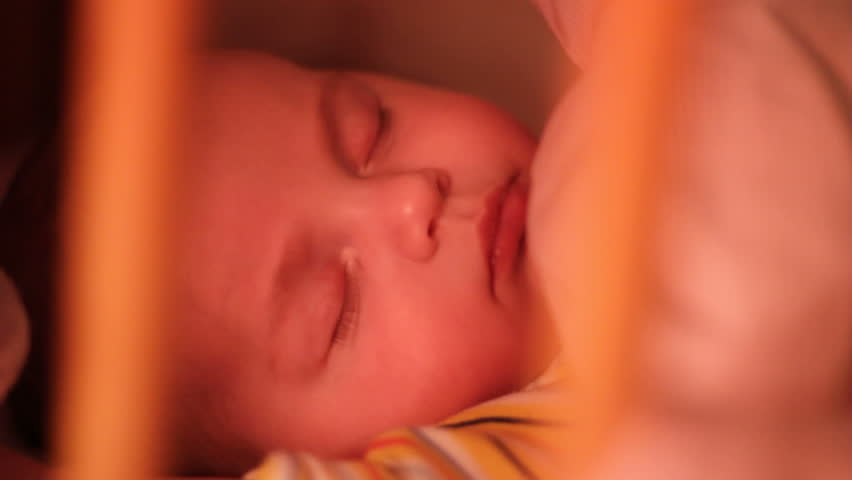 Infant asleep in crib