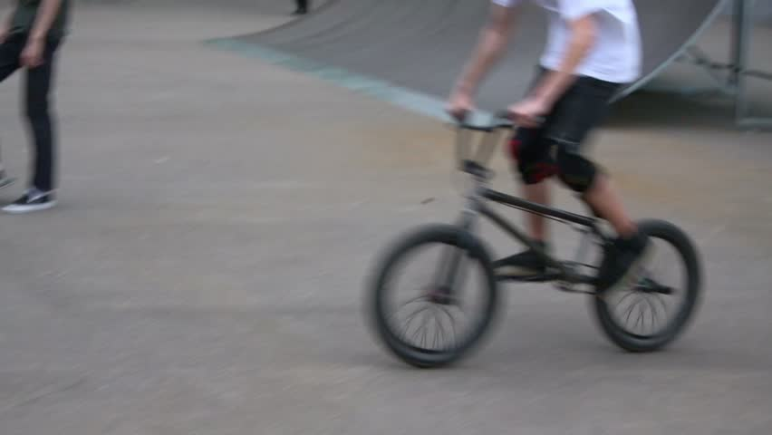 MOSCOW - MAY 12: Boy rides on bike by ramps at opening of skatepark in Culture and Recreation Park Sokolniki on 12 May 2012, Moscow, Russia. Skatepark in Sokolniki is pilot project of this format.   Shutterstock HD Video #4804127