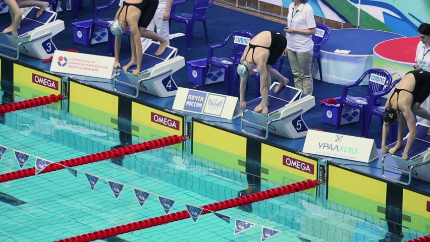 MOSCOW - APR 20: Women jump into water and swim breaststroke in pool during Championship of Russia in Olympic Sports complex on 20 April 2012 in Moscow, Russia