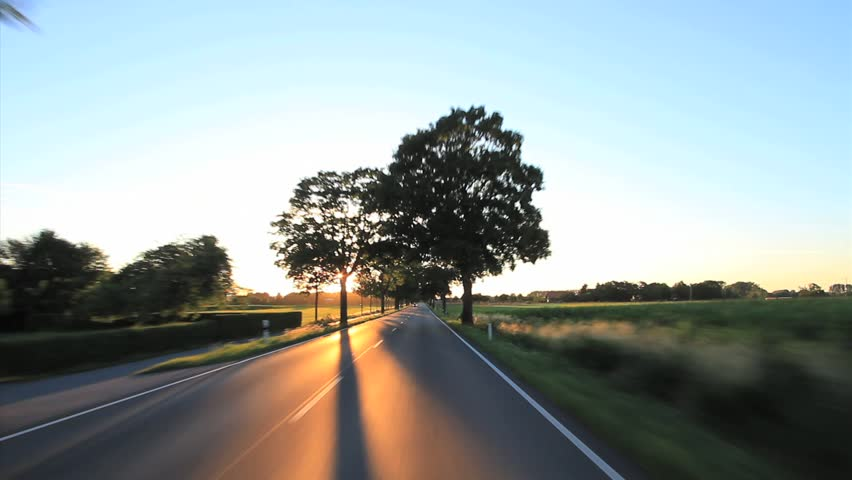 Driving a car on a sunny day on a road into the sunset, Point of View - POV, with a roof-mounted, Germany.  | Shutterstock HD Video #4822019