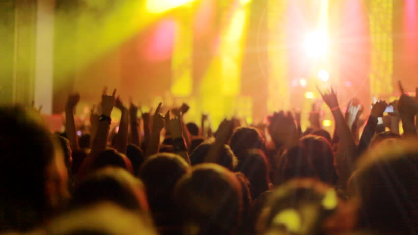 Crowd partying at a rock concert. silhouetted hands and flashing lights. #4826789