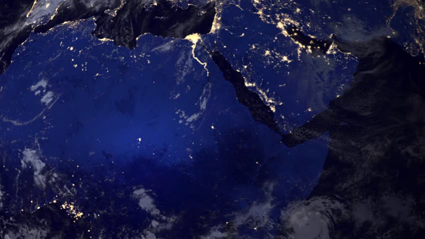 Telecommunication satellite over Africa and Arab peninsula, night view from space.. Cinema quality 3D animation. HD. The focus changes from earth to satelite and back through the clouds.