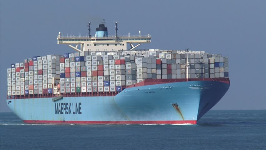 NORTH SEA -  27 SEPTEMBER 2013: Ultra large container vessel Elly Maersk bound for Port of Rotterdam, The Netherlands + zoom out basalt blocks, Maasmond, Port of Rotterdam.