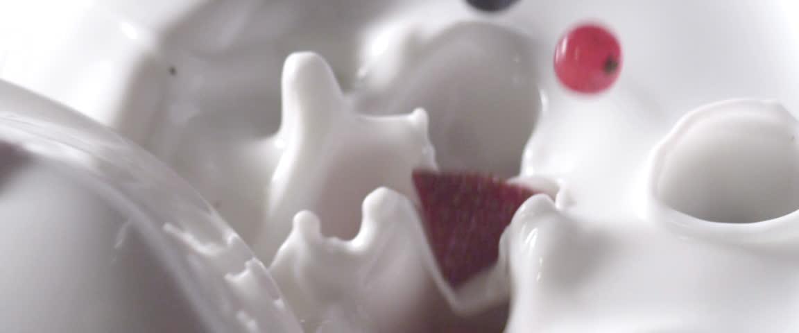Berries falling into yoghurt (close-up) #4839947