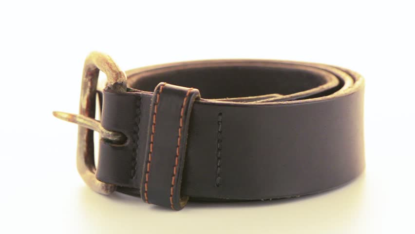 Leather belt rotating on white background. | Shutterstock HD Video #4841507