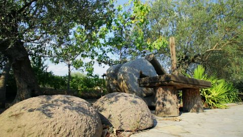 The Old Cold Stone Press of Olive Oil. The Old Mill Stones of Traditional Olive Oil Extracting (Dolly-in)