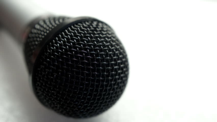 Microphone. A close up sliding, tracking shot of a Microphone offset composition for text overlays, filmed on the Blackmagic Cinema Camera.