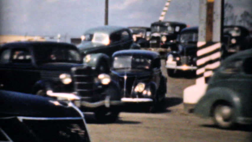 DETROIT, MICHIGAN - CIRCA 1940: Old antique cars zooming around during rush hour traffic in Detroit and using the new highway in 1940.