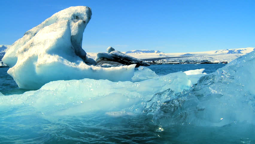 Glacial ice slowly melting into the lake through global warming 60 FPS | Shutterstock HD Video #487894