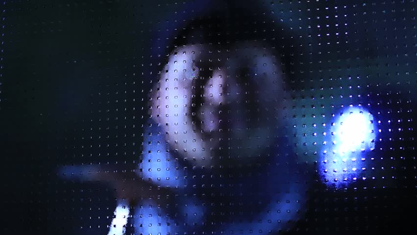 Burglar on a door.    Shutterstock HD Video #4879871