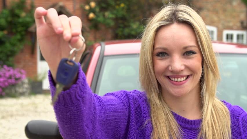 Portrait of a happy teenage girl dangling new car keys in slow motion #4885859