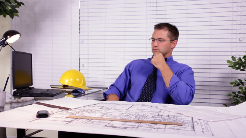 Stock Video Clip Of A Young Architect, Builder, Or Designer In |  Shutterstock