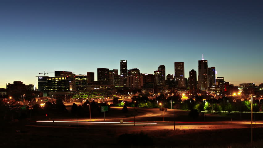 Downtown Denver, Colorado at Sunrise, with Interstate highway in the foreground. Ultra HD 4K long exposure time lapse.