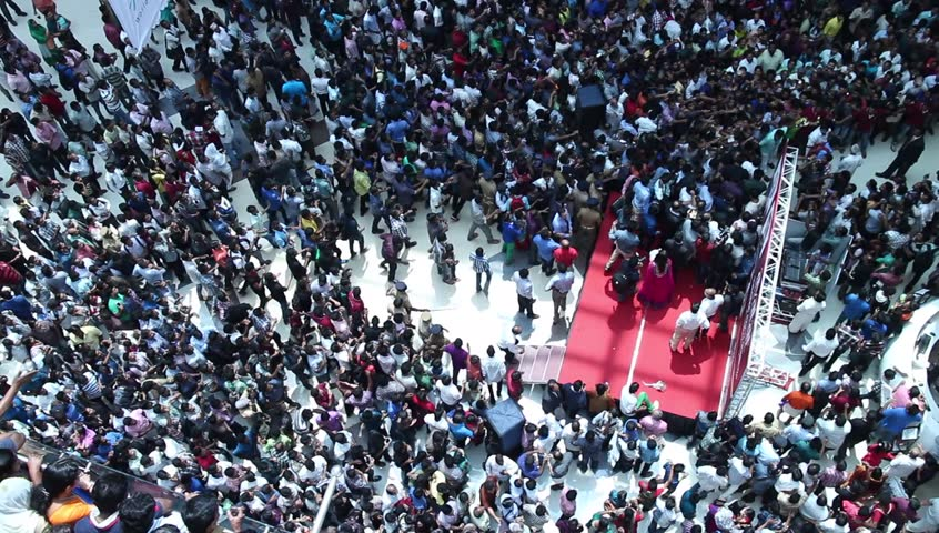 Crowded shopping at mall season sale in India. Indian crazy crowd of people running behind a celebrity. Unusual. Commuters aerial view.Group of Indian people / shoppers walking / rushing top view