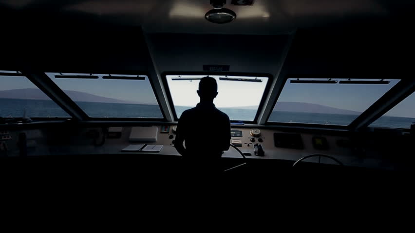 Captain on deck of large ship