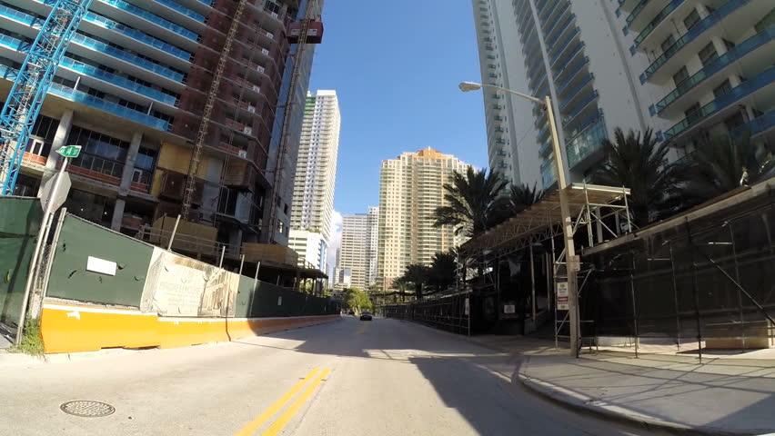 MIAMI - OCTOBER 11: Drivers pov vehicle driving along the streets of Brickell Miami October 11, 2013 in Miami, USA. Brickell is Miami's major financial district.    Shutterstock HD Video #4905239
