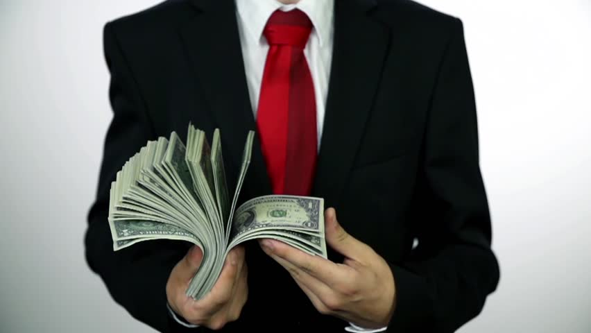 Man in suit counting banknote money. Slow motion money shots of young business man full of corrupted money, throwing it in the air and bribing.