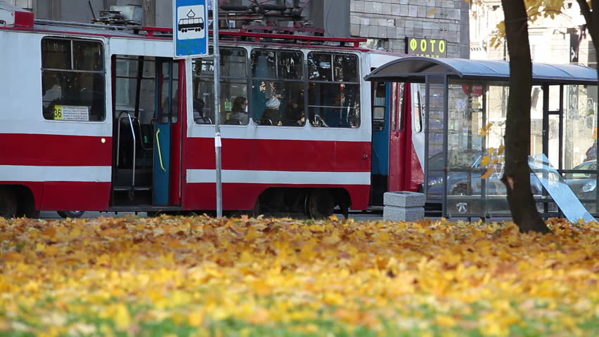 SAINT-PETERSBURG, RUSSIA - CIRCA SEPTEMBER, 2013: City tram stop in autumn season on circa September, 2013 in Saint-Petersburg, Russia. Electrical and ecological urban public transport