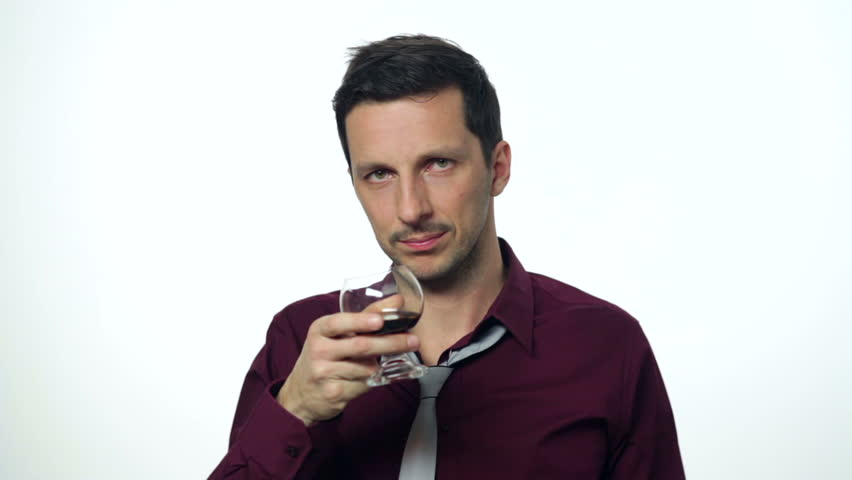 Man in business attire drinking too much alcohol. Studio setting on a white background. High definition video.