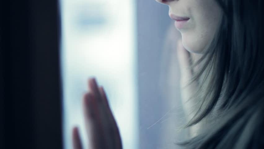 Sad girl near window thinking about something | Shutterstock HD Video #4953311